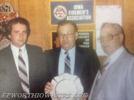 Captain Vince Kramer received the first Epworth Fire Department Firefighter of the Year award in 1982.  Shown with Senator Joe Welsh, Vince and Fire Chief Dan McDermott.
