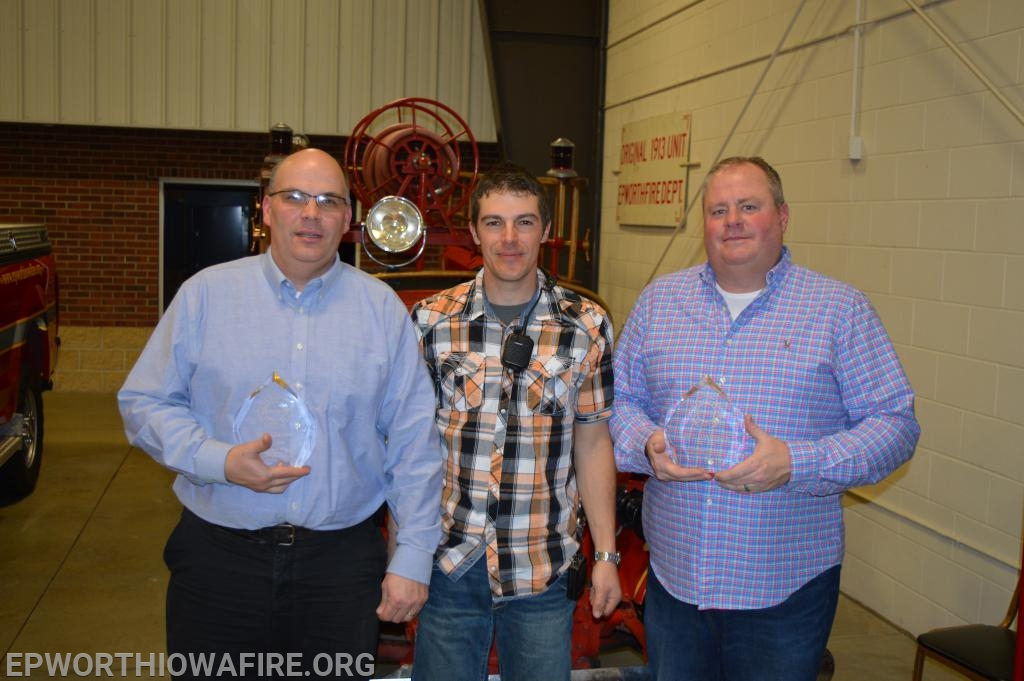 President Kyle Mueller presented Dan Kramer and Tom Berger awards for 30 years of service to the department.