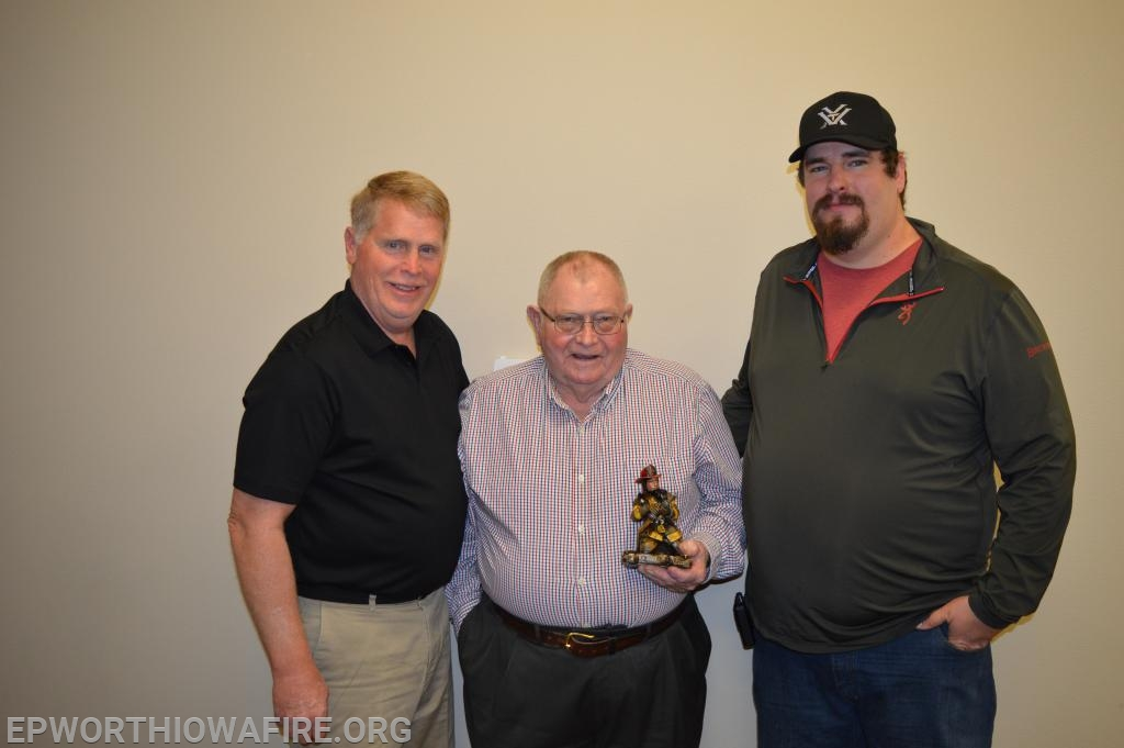Three generations of service to the Epworth Fire Department.  Firefighter Mitch Beyer is pictured with his uncle and new board member Ken Beyer and his Grandpa Bill Beyer.