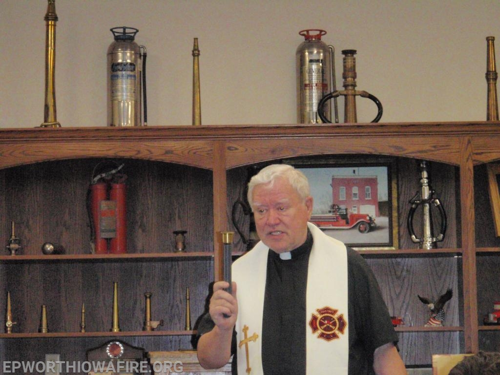 Fr. Bobby conducts a blessing of the new fire station on March 15, 2009.