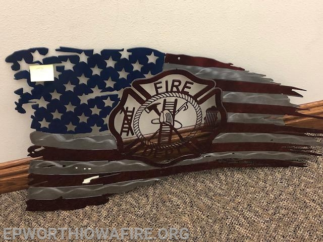 Metal Flag Donated by Mike Timmerman, Austin and Taylor Schmit.